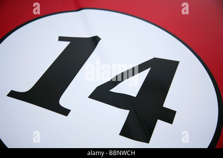 Number 14 in white circle on red background. - Stock Photo