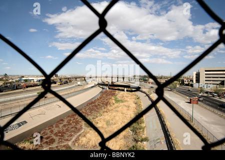 Border Wall at Train Crossing and Rio Grande River, U.S. Border Patrol (El Paso Sector) with view of Ciudad Juarez, - Stock Photo