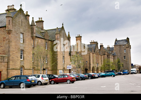 Main street in Dornoch, east coast, Sutherland, Scotland showing Dornoch castle hotel and the old jail - Stock Photo