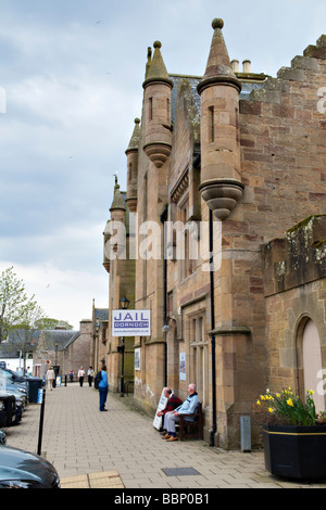 Main street in Dornoch showing the old jail, East coast in Sutherland, Scotland - Stock Photo