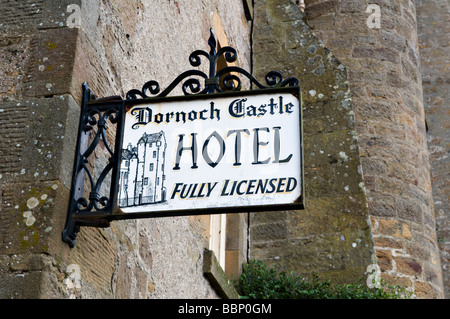 Close up of old fashioned wrought iron sign post from the Dornoch Castle Hotel, Dornoch, east coast, Sutherland, - Stock Photo