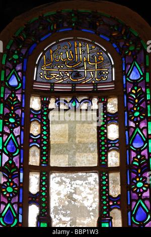 Colorful stained glass windows with Arabic inscription, apse, Hagia Sophia, Aya Sofya, Sultanahmet, Istanbul, Turkey - Stock Photo