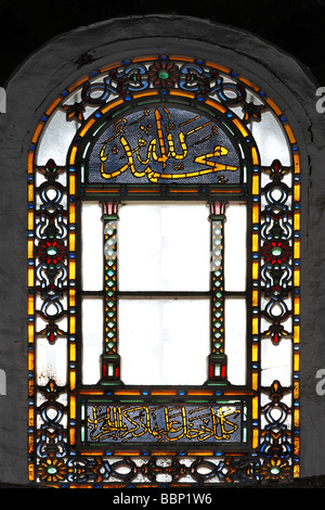 Colorful stained glass windows with Arabic inscription, apse, Hagia Sophia, Aya Sofya, Sultanahmet, Istanbul, Turkey - Stock Photo