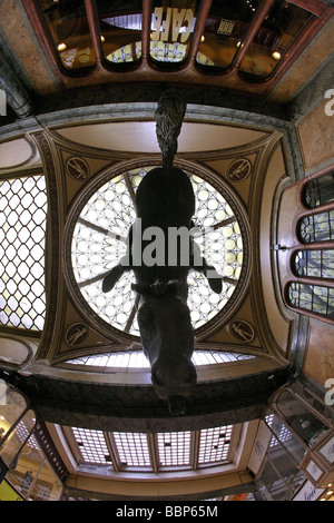 Statue of Vaclav Wenceslas on inverted horse suspended in shopping arcade - Stock Photo