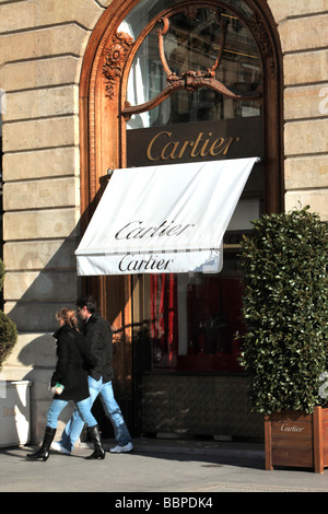 COUPLE IN FRONT OF THE CARTIER BOUTIQUE, PLACE VENDOME, PARIS, FRANCE, EUROPE - Stock Photo