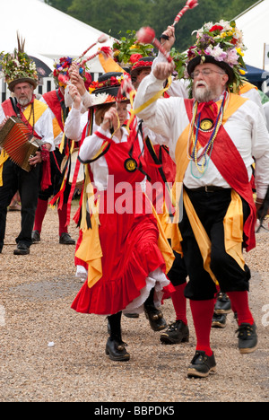 Traditional morris dancers (Knockhundred Shuttles Clog Morris) in full dress and hats at a country garden show - Stock Photo
