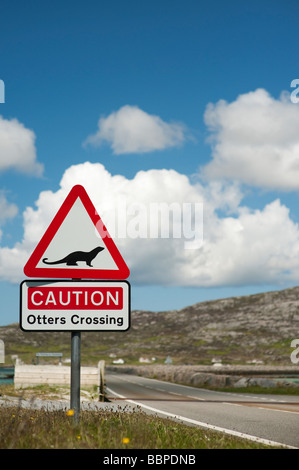 Otter crossing road sign, Eriskay causeway, South Uist, Outer Hebrides, Scotland - Stock Photo