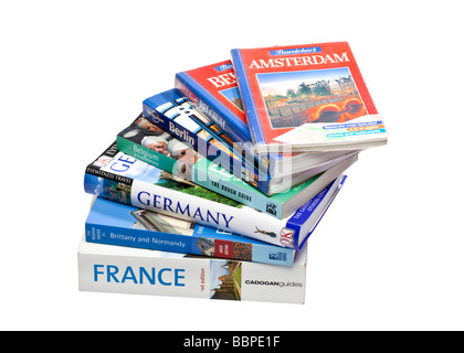 Stack of European travel guide books on white - Stock Photo