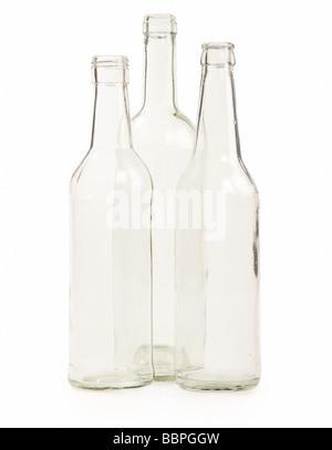 Three empty bottles on a white background - Stock Photo