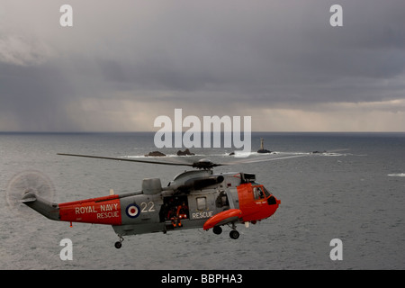 Royal Navy Sea King Rescue helicopters hovering off Lands End - Stock Photo