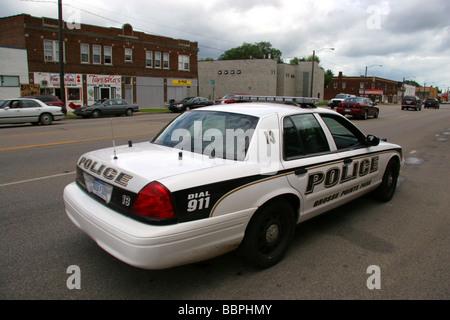 Grosse Pointe Park police car on patrol on Mack Avenue Detroit Michigan USA - Stock Photo