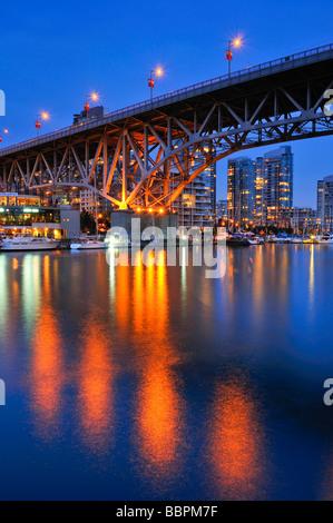 Skyline of Vancouver Down town in the evening light, on False Creek, Granville Street Bridge, British Columbia, - Stock Photo