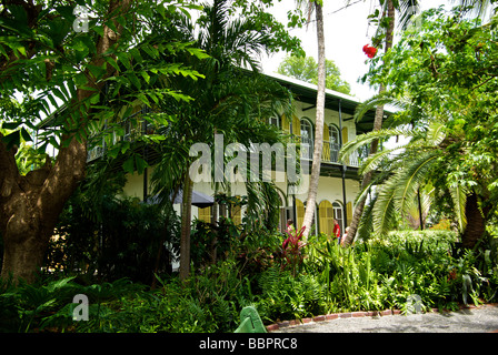 Lush tree growth around gardens of Ernest Hemingway heritage home museum 'Key West Florida' - Stock Photo