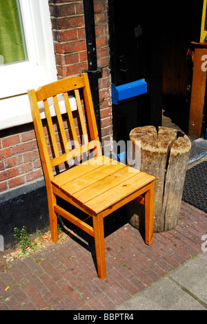 A wooden chair and the wood it once was - Stock Photo