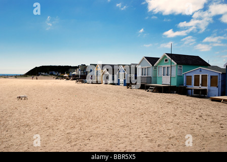 A row of large deluxe beach huts - Stock Photo