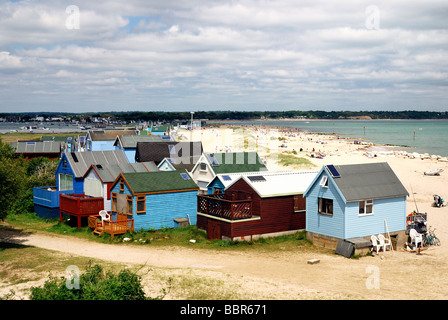 Beach huts along sandy beach at Hengistbury Head Dorset - Stock Photo