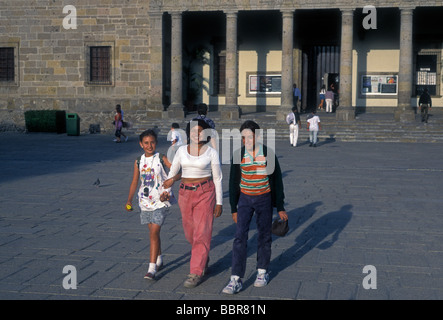 Mexicans, Mexican people, adult woman, boy, girl, mother and children, Instituto Cultural Cabanas, background, Guadalajara, - Stock Photo