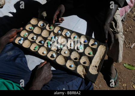 Men playing Bao, a traditional Malawian board game in Malawi - Stock Photo