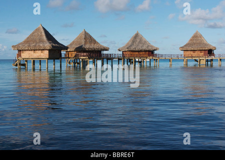 BUNGALOWS ON PILES AT THE HOTEL TIKEHAU PEARL BEACH RESORT, TIKEHAU ISLAND, TUAMOTU ISLANDS, FRENCH POLYNESIA - Stock Photo