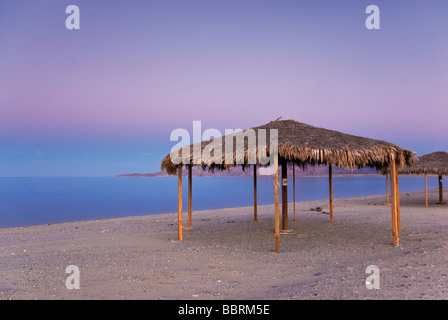 Palapa on beach after sunset at Campo Rancho Grande in Baja California Mexico - Stock Photo