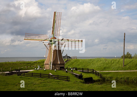 Windmill on dyke Zuiderzeemuseum Enkhuizen Netherlands - Stock Photo