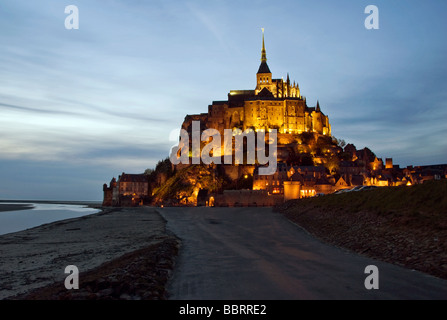 France Normandy Couesnon Avranches Mont-Saint-Michel St Michael's Mount peninsula evening sunset illuminate light - Stock Photo