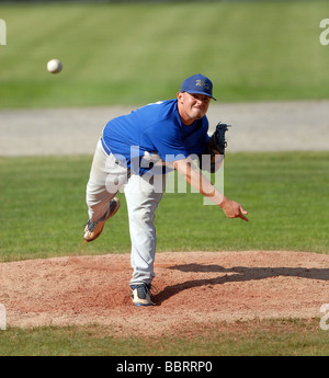 High school pitcher throwing ball during State Championship baseball game in CT USA - Stock Photo