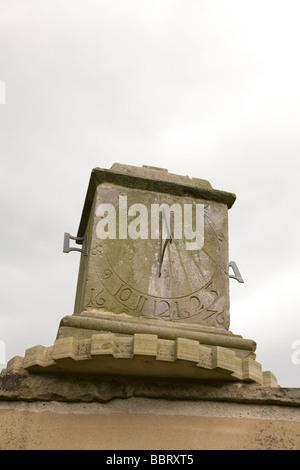 A sundial on an overcast day. - Stock Photo