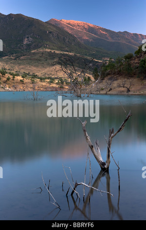 The landscape at dusk around the Embalse de Zahara - El Gastor in the Province of Cadiz, Andalusia, Spain. - Stock Photo