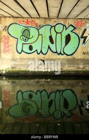 Graffiti Under the Roman Road Bridge crossing The Regent's Canal London - Stock Photo