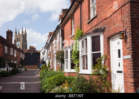 Red brick terraced houses on a narrow residential street in Tenterden Kent England UK Britain - Stock Photo