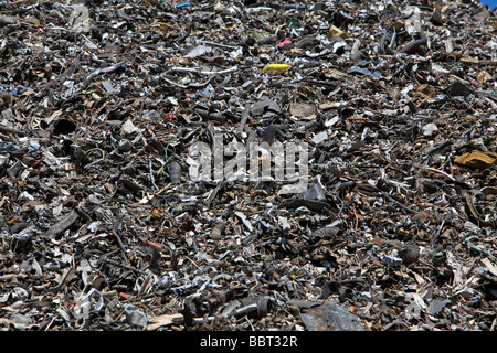 A heap of processed scrap metals at a recycling centre - Stock Photo