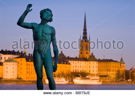 Statue at Stadshuset (City Hall), with Riddarholmen in the background, Stockholm, Sweden. - Stock Photo