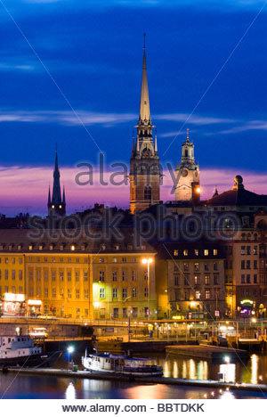 Gamla Stan, the old town of Stockholm, at night, from Katarinavägen, Sweden. - Stock Photo