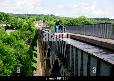 Barge travelling over Pontcysyllte Aqueduct on the Llangollen Canal - Stock Photo