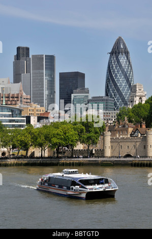 High speed Clipper commuter and tour catamaran in the Pool of London with Tower of London & City of London skyline - Stock Photo