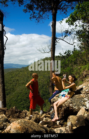 Trekkers resting on the way to Agua Fria Waterfall Chapada dos Veadeiros Veadeiros Tableland Goias Brazil - Stock Photo
