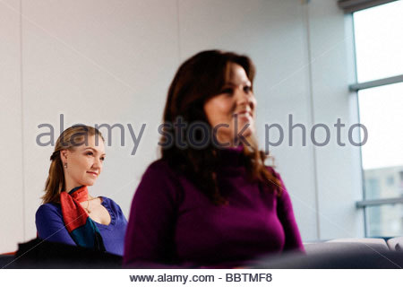 Women paying attention to what is told - Stock Photo
