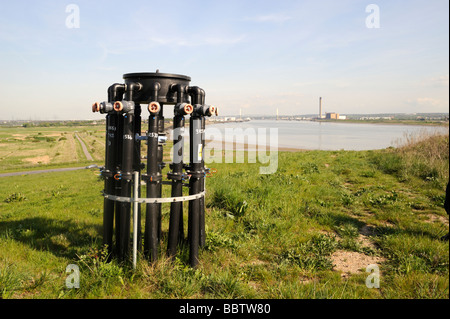 Rainham Essex,landfill site,pipes for siphoning methane gas to local power plant,view across Thames to Kent,UK - Stock Photo