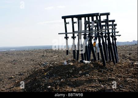 Pipes for siphoning methane gas from Rainham landfill site to local power generating plant,Rainham Essex,UK - Stock Photo