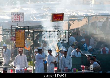 Bustling market stalls in the Djemaa el Fna square in Marrakesh Morocco - Stock Photo