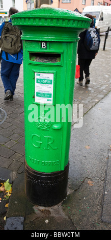 Old British Post Box from the era of King George now painted Kelly Green. Old green postbox on a street corner. - Stock Photo