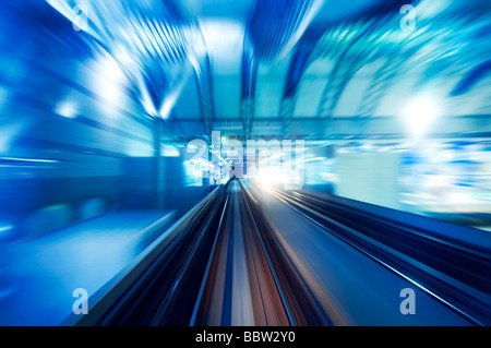 High speed train entering station platform. Focus on the rail road. - Stock Photo