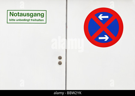 White door with emergency exit sign, do not block, stopping restriction on left and right - Stock Photo