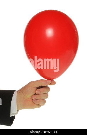Manager's hand holding a balloon - Stock Photo