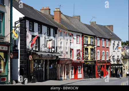 Row of old storefronts along main shopping high street in Kilkenny city Southern Ireland - Stock Photo