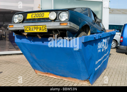 £2000 scrappage government incentive scheme, car in skip, norfolk, england - Stock Photo