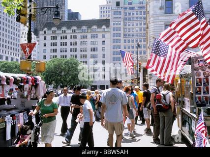 New York City Bergdorf Goodman Grand Army Plaza Fifth Avenue Street Vendors and Pedestrians American Flags USA - Stock Photo