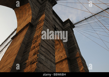 One of the stone supporting towers of the Brooklyn Bridge, which connects Manhattan and Brooklyn - Stock Photo