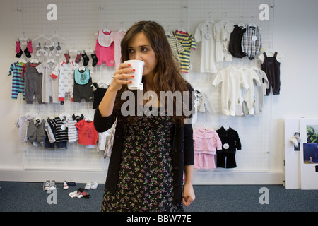 Personality Myleene Klass during promo filming before launch of her own Baby K collection at Mothercare s UK HQ - Stock Photo